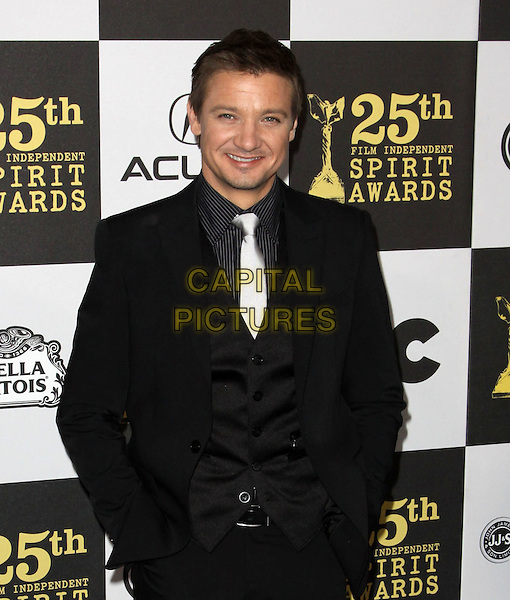 JEREMEY RENNER .25th Annual Film Independent Spirit Awards held At The Nokia LA Live, Los Angeles, California, USA,.March 5th, 2010 ..arrivals Indie Spirit half length black suit tie waistcoat white silver hands in pockets .CAP/ADM/KB.©Kevan Brooks/Admedia/Capital Pictures