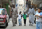 Refugee mothers from South Sudan walk their children to school in Cairo, Egypt. The children attend a school operated by St. Andrew's Refugee Services, which is supported by Church World Service.
