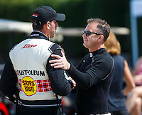 Jul 10, 2016; Joliet, IL, USA; NHRA top fuel driver Steve Torrence (right) greets T.J. Zizzo during the Route 66 Nationals at Route 66 Raceway. Mandatory Credit: Mark J. Rebilas-USA TODAY Sports