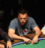 BEN AFFLECK.The Ante Up for Africa Celebrity Poker Tournament at the Rio Resort Hotel and Casino, Las Vegas, Nevada, USA..July 2nd, 2009.half length table bet betting chips cards blue t-shirt funny face tongue .CAP/ADM/MJT.© MJT/AdMedia/Capital Pictures