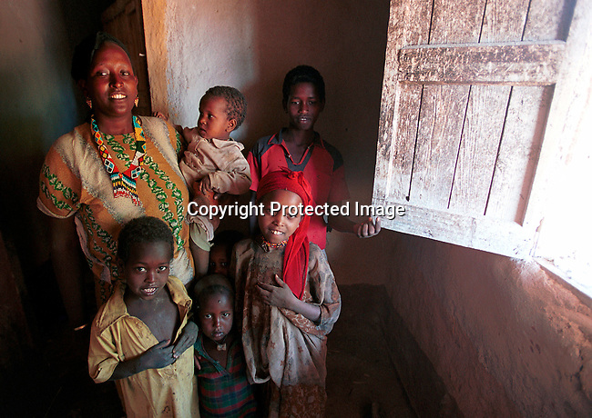 dicoeth00100.Ethiopia. Nuria Hussein, age 44, and her children in their home on February 9, 2001 in Erer Valley in eastern Ethiopia. Nuria feels strongly against Female Genital Mutilation (FGM) and is working with Karl-Heinz Bohm, the Austrian  actor, personality in his organisation Menschen for Menschen in trying to stop the practice in Ethiopia. .©Per-Anders Pettersson/iAfrika Photos