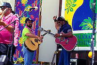 Cyril Pahinui, a musician, performing on stage at the Hawaiian slack key guitar festival