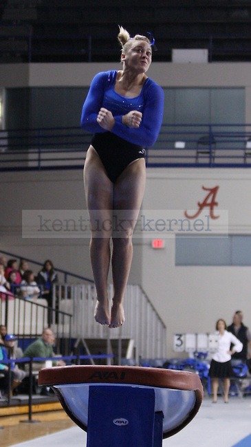 Senior Storey Morris performs on the vault during the  University of Kentucky gymnastics meet against the University of Alabama, in Memorial Coliseum, on Friday, Feb. 10, 2012. Photo by Latara Appleby | Staff ..