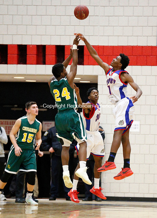 Waterbury, CT- 13 January 2016-011316CM05-  Crosby's Jeremiah Kendall, blocks a shot by Holy Cross' Jon Mowatt during their NVL matchup in Waterbury on Wednesday.  Crosby would go onto win, 66-59.   Christopher Massa Republican-American