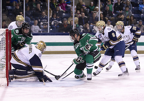 November 23, 2012:  Notre Dame goaltender Steven Summerhays (#1) makes save on shot by North Dakota forward Derek Rodwell (#11) during NCAA Hockey game action between the Notre Dame Fighting Irish and the North Dakota Fighting Sioux at Compton Family Ice Arena in South Bend, Indiana.  North Dakota defeated Notre Dame 2-1.
