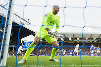 Tim Howard reacts angrily  after conceding the opening goal during the Barclays Premier League match between Everton and Swansea City played at Goodison Park, Liverpool