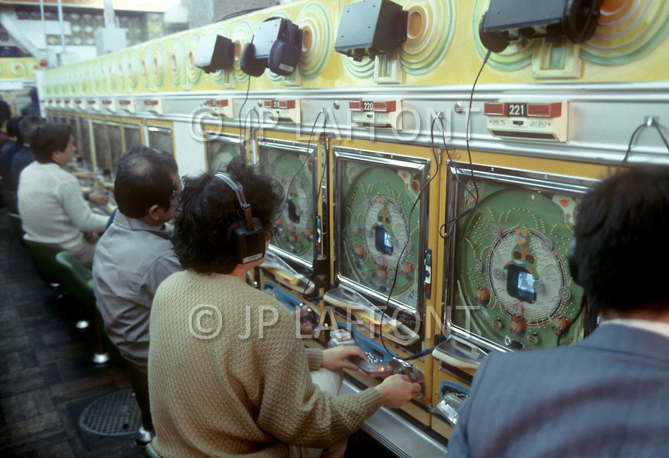 October, 1980. Tokyo, Japan. People gather in an archade to play the popular gambling game Pachinko.