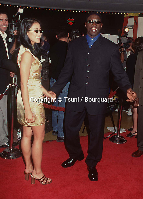 Nakyung (Nikki) Park and husband Wesley Snipes