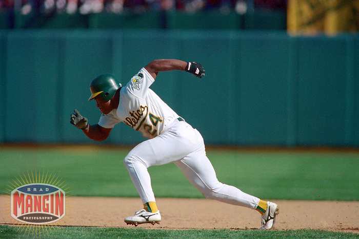 OAKLAND, CA - Rickey Henderson of the Oakland Athletics runs the bases during Game 3 of the American League Championship Series against the Toronto Blue Jays at the Oakland Coliseum in Oakland, California in 1992. Photo by Brad Mangin