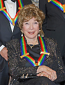 Actress Shirley MacLaine waits to pose for a group photo with the other four recipients of the 2013 Kennedy Center Honors following a dinner hosted by United States Secretary of State John F. Kerry at the U.S. Department of State in Washington, D.C. on Saturday, December 1, 2013.  The 2013 honorees are opera singer Martina Arroyo; pianist, keyboardist, bandleader and composer Herbie Hancock; pianist, singer and songwriter Billy Joel; actress Shirley MacLaine; and musician and songwriter Carlos Santana.<br /> Credit: Ron Sachs / CNP