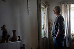 'David in Dot's old house, 2018' from Colin McPherson's project 'Treasured Island' part of the Document Scotland exhibition entitled 'A Contested Land' which will launch at the Martin Parr Foundation, Bristol, on 16th January, 2019. McPherson's work was made in 2018-2019 on Easdale, the smallest permanently inhabited Inner Hebridean island and looks at the historical legacy of the island, once world famous for its slate mining industry.<br /> <br /> Photograph © Colin McPherson, 2018 all rights reserved.