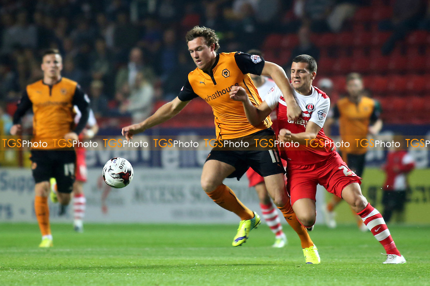 Kevin McDonald of Wolves tries to shake off a challenge from Charlton's George Tucudean - Charlton Athletic vs Wolverhampton Wanderers - Sky Bet Championship Football at the Valley, Charlton, London- 16/09/14 - MANDATORY CREDIT: Paul Dennis/TGSPHOTO - Self billing applies where appropriate - contact@tgsphoto.co.uk - NO UNPAID USE