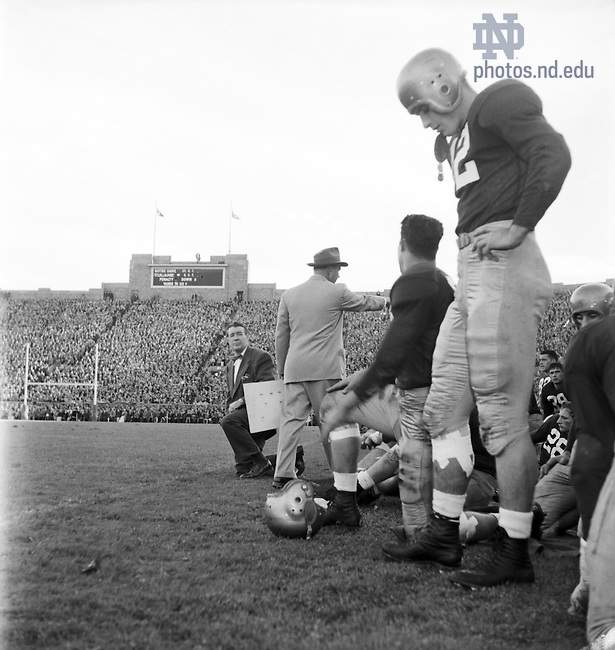 GMCJ 1/22:  Football Game Day - Notre Dame vs. Tulane, 1949/1015.  Coach Frank Leahy, assistant coaches, and players on the sidelines..Image from the University of Notre Dame Archives.
