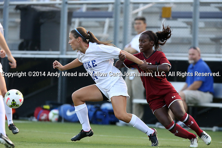 14 August 2014: Duke's Morgan Reis (24) and South Carolina's Raina Johnson (right). The Duke University Blue Devils hosted the University of South Carolina Gamecocks at Koskinen Stadium in Durham, NC in a 2014 NCAA Division I Women's Soccer preseason match. Duke won the exhibition 2-0.