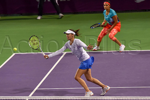 23.02.2016. Doha, Qatar. Qatar Total Open championships.  Martina Hingis (Front) of Switzerland and Sania Mirza of India compete during their womens doubles second round match against Zheng Saisai and Xu Yifan of China at the WTA Tennis Damen Qatar Open 2016 in Doha, Qatar, Feb. 23, 2016. Martina Hingis and Sania Mirza won 2-1.