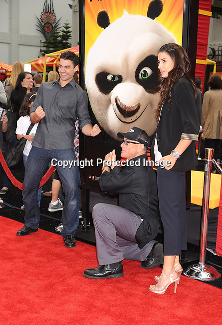 """HOLLYWOOD, {CA} -MAY 22: Jean-Claude Van Damme and family arrive at the Los Angeles premiere of """"Kung Fu Panda 2"""" held at Grauman's Chinese Theatre on May 22, 2011 in Hollywood, California."""