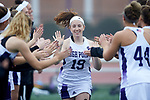 Meredith Chapman (19) of the High Point Panthers high fives teammates during player introductions prior to the match against the Furman Purple Paladins at Vert Track, Soccer & Lacrosse Stadium on February 10, 2018 in High Point, North Carolina.  The Panthers defeated the Purple Paladins 17-6.  (Brian Westerholt/Sports On Film)