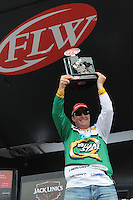 NWA Democrat-Gazette/FLIP PUTTHOFF <br /> Scott Canterbury of Springville Ala., hoists his trophy after winning the Walmart FLW Tour bass tournament Sunday, April 17, 2016 at Beaver Lake. Cantuerbury held on to his Saturday lead for the win on Sunday and the $125,000 first prize.