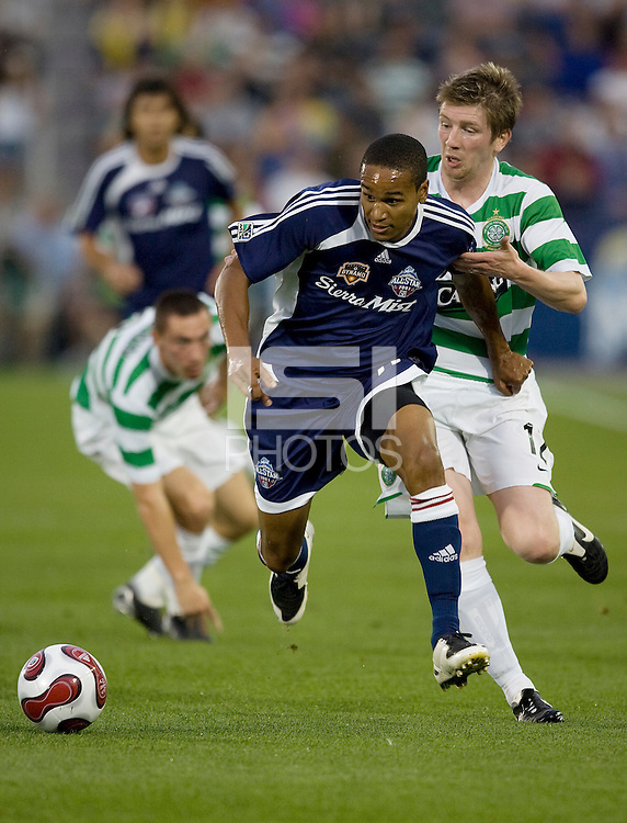 MLS All-Star Ricardo Clark (26) is chased by Celtic FC Mark Wilson (12). The MLS All-Stars defeated Celtic FC 2-0 in the Sierra Mist MLS All-Star Game at Dick's Sporting Goods Park, Commerce City, Colorado, on July 19, 2007.