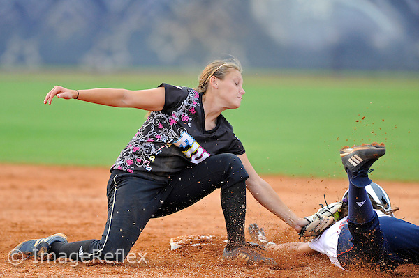 6 May 2011:  FIU's Kayla Burri (7) tags FAU's Brittany Walker (9) out to prevent her from stealing second as the FIU Golden Panthers defeated the Florida Atlantic University Owls, 1-0, at the FIU Softball Complex in Miami, Florida.