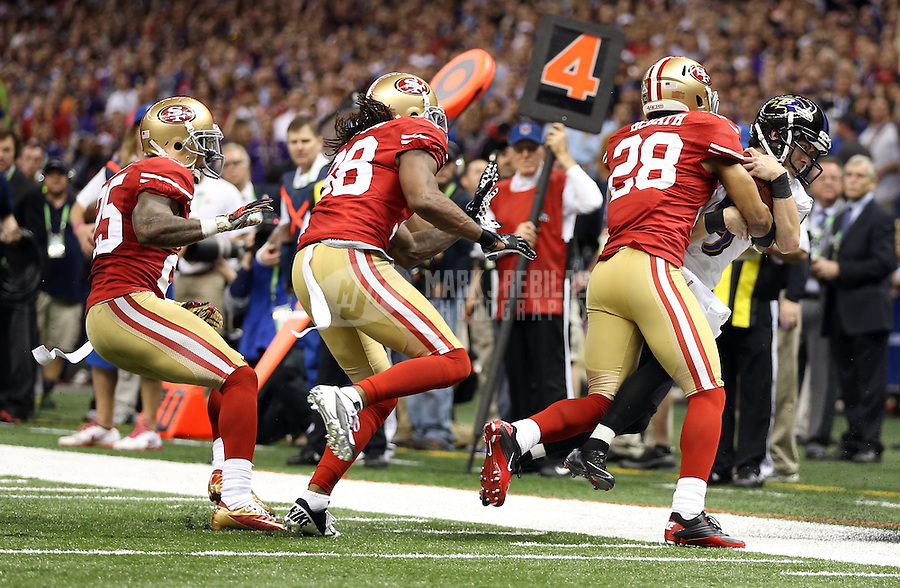 Feb 3, 2013; New Orleans, LA, USA; Baltimore Ravens kicker Justin Tucker (9) is tackled by San Francisco 49ers defensive back Darcel McBath (28) on a fake field goal in the second quarter in Super Bowl XLVII at the Mercedes-Benz Superdome. Mandatory Credit: Mark J. Rebilas-