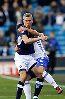 Maxime Colin of Birmingham City holds onto Steve Morison of Millwall during the Sky Bet Championship match between Millwall and Birmingham City at The Den, London, England on 21 October 2017. Photo by Carlton Myrie.