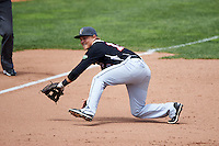 New Britain Rock Cats third baseman Pat Valaika (12) fields a grounder during a game against the Akron RubberDucks on May 21, 2015 at Canal Park in Akron, Ohio.  Akron defeated New Britain 4-2.  (Mike Janes/Four Seam Images)