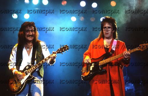 URIAH HEEP - Bassist Trevor Bolder (9 June 1950 – 21 May 2013) and former member of David Bowie's band The Spiders from Mars from 1970-1973.  Photographed performing live with guitarist Mick Box in pre-glasnost Russia at the Olympic Stadium in Moscow where the band played ten consecutive nights to a total of 180,000 people - Moscow Russia - December 1987.  Photo credit: Ray Palmer Archive/IconicPix