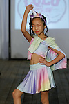 Child model walks runway in an outfit from the Sugar Lulu collection, during the KidFash Magazine runway show in Brooklyn, New York on Nov 4, 2017.