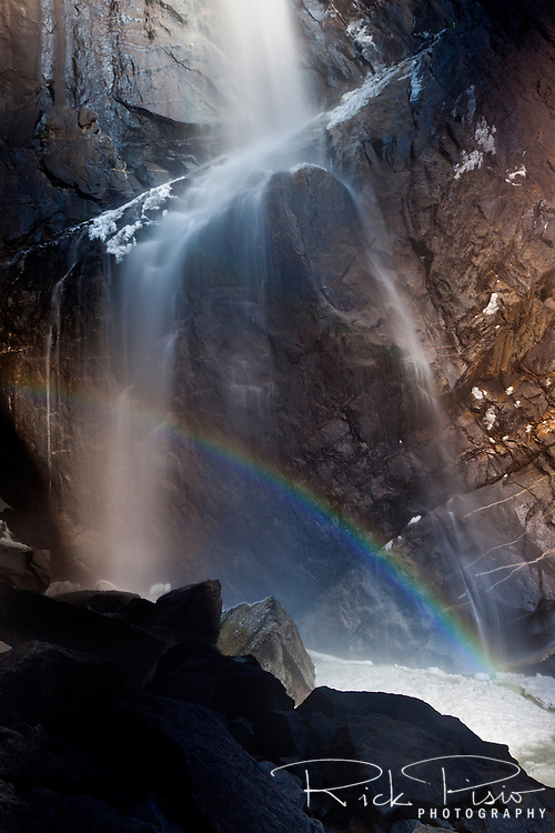 Water, rainbow, and frazil ice at the base of Lower Yosemite Falls in Yosemite National Park