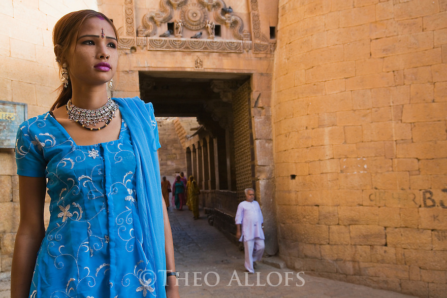 Rajasthani girl near entrance gate of Jaisalmer Fort in blue saree, Jaisalmer, Rajasthan, India --- Model Released