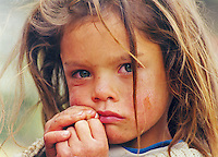 Portrait of poor child with emerald green eyes, Venezuela Few years ago photographers Anthony Asael and Stepahnie Rabemiafara dreamed a dream that seemed quite imposible: to visit every country of the World promoting arts and tolerance among children and, of course, taking photographs of them. With little money and resources but an impressing will, the duo got an astonishing goal. In four years they visited 300 schools in 192 countries where kids participating of the project created 18,000 pieces of artwork. <br />