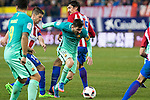 Atletico de Madrid's midfielder Gabi Fernandez (L), defender Stefan Savic (R) and FC Barcelona's forward Leo Messi (C) competes for the ball with  during the match of Copa del Rey between Atletico de  Madrid and Futbol Club Barcelona at Vicente Calderon Stadium in Madrid, Spain. February 1st 2017. (ALTERPHOTOS/Rodrigo Jimenez)