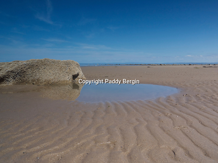 A West Wales beach in summer when at low tides the warm coastal winds can slowly create patterns in the sand.<br /> <br /> Stock Photo by Paddy Bergin