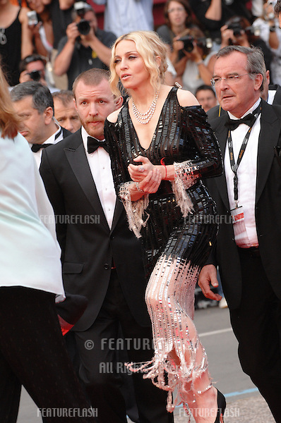 "Madonna & husband Guy Ritchie at the premiere of ""Che"" at the 61st Annual International Film Festival de Cannes. Her documentary ""I Am Because We Are"" is screening at the Festival..May 21, 2008  Cannes, France..Picture: Paul Smith / Featureflash"