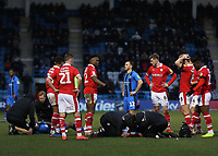 Barnsley players show their concern as Kieffer Moore is treated by the Barnsley medical team after suffering a nasty injury from a clash of heads during Gillingham vs Barnsley, Sky Bet EFL League 1 Football at The Medway Priestfield Stadium on 9th February 2019
