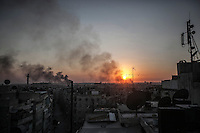 Smoke rises over the old city district where the heavy fighting and shelling have taken place during the battle in the last week between rebel forces and Syrian army for the control of Aleppo City.