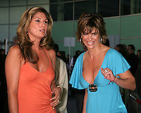 "©2004 KATHY HUTCHINS /HUTCHINS PHOTO.PREMIERE OF ""CATWOMAN"".HOLLYWOOD, CA.JULY 19, 2004..DAISY FUENTES.LISA RINNA"