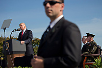 A member of the United States Secret Service stands watch while U.S. President Donald J. Trump, left, speaks during a ceremony to commemorate the September 11, 2001 terrorist attacks, at the Pentagon in Washington, D.C., U.S., on Monday, Sept. 11, 2017. Trump is presiding over his first 9/11 commemoration on the 16th anniversary of the terrorist attacks that killed nearly 3,000 people when hijackers flew commercial airplanes into New York's World Trade Center, the Pentagon and a field near Shanksville, Pennsylvania.<br /> CAP/MPI/CNP/RS<br /> &copy;RS/CNP/MPI/Capital Pictures