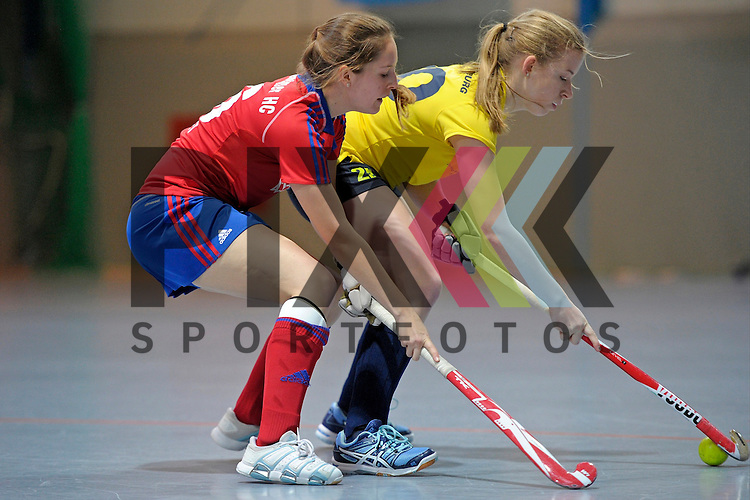 GER - Mannheim, Germany, January 17: During the Oberliga-Damen indoor hockey match between Feudenheimer HC (red) and  TSV Ludwigsburg (yellow) on January 17, 2016 at Irma-Roechling-Halle in Mannheim, Germany. Final score 8-2 (HT 3-1).  Kira Hallmann  #20 of TSV Ludwigsburg, Roswitha Posset #16 of Feudenheimer HC<br /> <br /> Foto &copy; PIX-Sportfotos *** Foto ist honorarpflichtig! *** Auf Anfrage in hoeherer Qualitaet/Aufloesung. Belegexemplar erbeten. Veroeffentlichung ausschliesslich fuer journalistisch-publizistische Zwecke. For editorial use only.