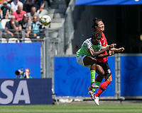 GRENOBLE, FRANCE - JUNE 12: Asisat Oshoala #8 of the Nigerian National Team, Boram Hwang #4 of the Korean National Team battle for head ball during a game between Korea Republic and Nigeria at Stade des Alpes on June 12, 2019 in Grenoble, France.
