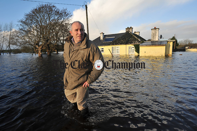Hugh O Donnell returns to survey damage at the family home in Beagh, Gort. His family, including his 87 year old mother Mary, were air lifted by Shanon Rescue helicopter from the house. Photograph by John Kelly.
