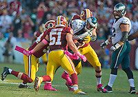 Philadelphia Eagles quarterback Carson Wentz (11) is sacked in the fourth quarter by Washington Redskins outside linebacker Preston Smith (94), defensive end Trent Murphy (93) and inside linebacker Will Compton (51) at FedEx Field in Landover, Maryland on Sunday, October 16, 2016.  looking on is Philadelphia Eagles center Jason Kelce (62).  The Redskins won the game 27 - 20.<br /> Credit: Ron Sachs / CNP /MediaPunch