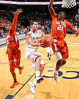 Feb. 2, 2011; Charlottesville, VA, USA; Virginia Cavaliers guard Sammy Zeglinski (13) shoots between Clemson Tigers guard Demontez Stitt (2) and Clemson Tigers forward Bryan Narcisse (21) during the game at the John Paul Jones Arena. Virginia won 49-47. Mandatory Credit: Andrew Shurtleff