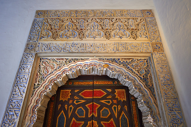 Arabesque Mudjar plasterwork and Zillige tiles of of the 12th century ) Alcazar of Seville, Seville, Spain