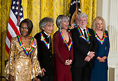 Actress and Broadway star Cicely Tyson (L), conductor Seiji Ozawa (C-L), actress and singer Rita Moreno (C), filmmaker George Lucas (C-R), singer-songwriter Carole King (R) attend the Kennedy Center Honorees Reception in the East Room of the White House in Washington, DC, USA, 06 December 2015. US President Barack Obama and First Lady Michelle Obama hosted the gathering. The 2015 Kennedy Center honorees are: singer-songwriter Carole King, filmmaker George Lucas, actress and singer Rita Moreno, conductor Seiji Ozawa, and actress and Broadway star Cicely Tyson.  <br /> Credit: Jim LoScalzo / Pool via CNP