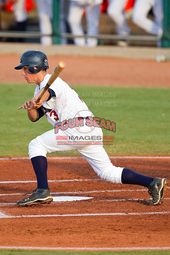 Alex Bregman #3 of the USA 18u National Team follows through on his swing against the USA Baseball Collegiate National Team at the USA Baseball National Training Center on July 2, 2011 in Cary, North Carolina.  The College National Team defeated the 18u team 8-1.  Brian Westerholt / Four Seam Images