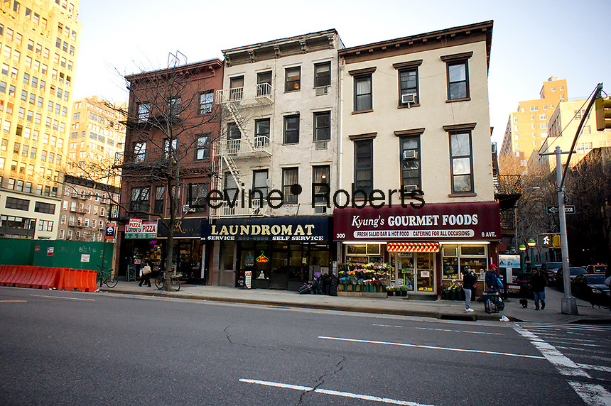 Tenements on Eighth Avenue in the New York neighborhood of Chelsea with retail on the first floor, seen on Saturday, January 28, 2012. (© Richard B. Levine)
