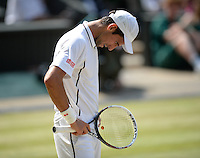 OIC - ENTSIMAGES.COM -  Novak Djokovic of Serbia during his match against Andy Murray of Great Britain Gentlemen's Singles Final match against of the Wimbledon Lawn Tennis Championships at the All England Lawn Tennis and Croquet Club 7th July 2013     Photo Ents Images/OIC 0203 174 1069