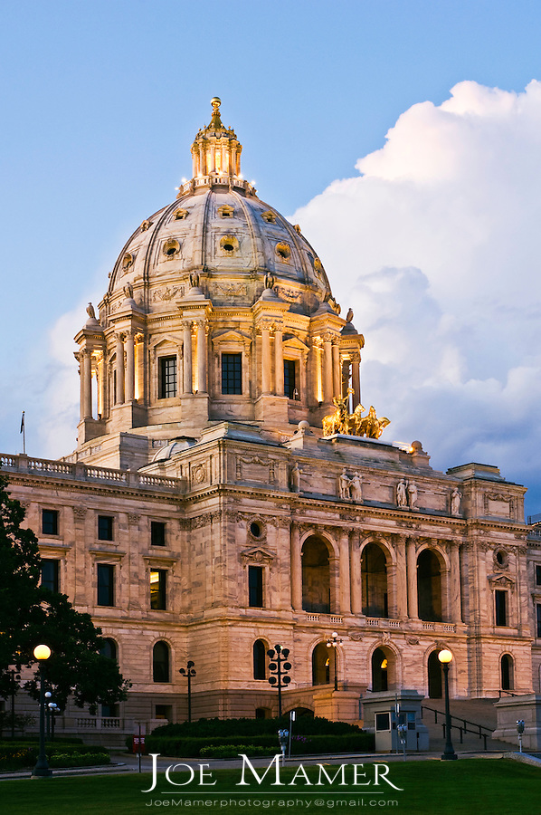 Minnesota State capitol building. The building was designed by Cass Gilbert. The unsupported dome is the second largest in the world, after Saint Peter's. Work began in on the capitol in 1896, and construction was completed in 1905. It is the third building to serve this purpose: the first capitol was destroyed by fire in 1881, and the second was completed in 1883, but was considered to be too small almost immediately...